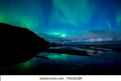 Northern lights and moonlight in Abisko national park in Sweden