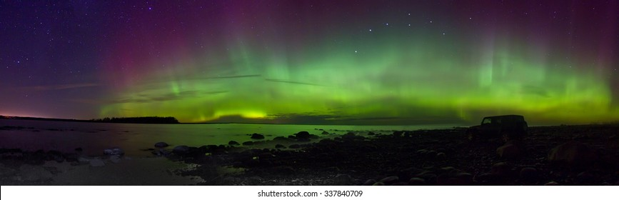 Northern lights on lake Ladoga, Russia, November 03, 2015 , travel by Jeep Wrangler