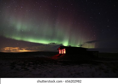 Northern Lights over an astronomy hut. Hella. Iceland.