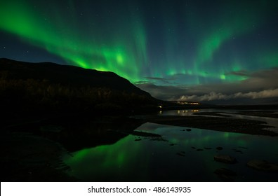 Northern lights over calm lake in Abisko national park in Sweden