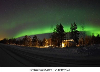 The Northern Lights over a Finnish small village in Lapland