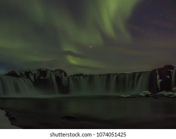 Northern lights over Godafoss watefall in Iceland