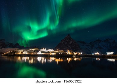 Northern lights over the mountain at sakrisoy rorbuer in winter season, Lofoten islands, Norway, Europe