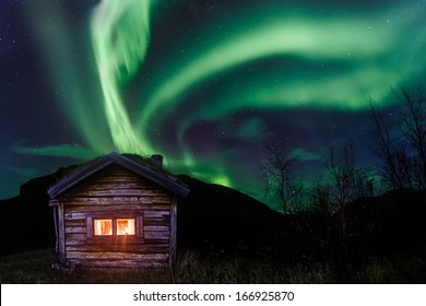 Northern lights over an old Cabin