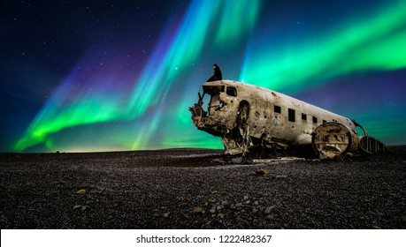 Northern lights over plane wreckage in Iceland