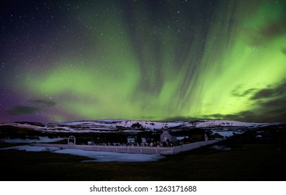 Northern Lights over Small Church in Iceland in Winter