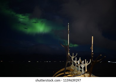 The Northern lights over the sun voyager in Reykjavik
