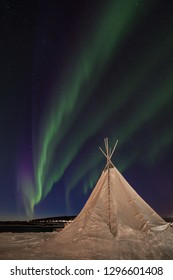 Northern lights over a traditional sami tipi in Northern Norway.
