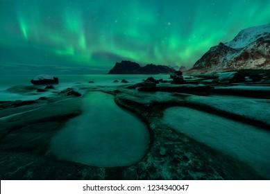 Northern lights over the Uttakleiv beach in Lofoten, Norway