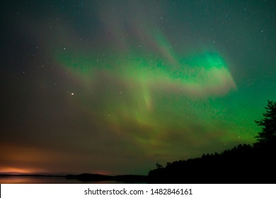 Northern Lights Over Water Northern Lights with Trees green dark night aurora