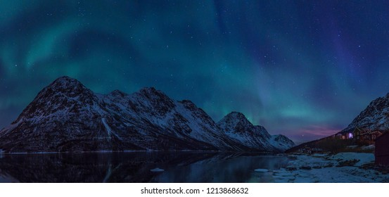 Northern lights panorama over norwegian fjord