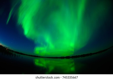 Northern Lights With Reflection In The Lake, in Naryan-Mar, Nenets Autonomous Area, Russia.