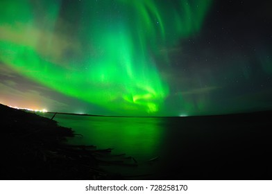 Northern Lights With Reflection In The River, in Naryan-Mar, Nenets Autonomous Area, Russia.