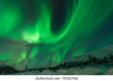 Northern Lights  As seen over a mountain in Tromso, Norway