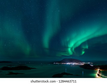 Northern lights and starry skies seen from the island Kvaløya just outside Tromsø city in northern Norway.