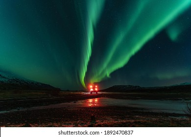 northern lights and a vehicle lights