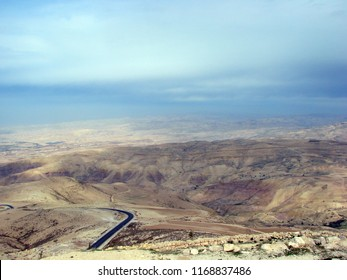 Northern part of Jordan. Moses mountain Nebo. 01. 14. 2017. A panorama from the top of the Dead Sea with the Jordanian coast on one side and the Israeli coast - on the other under a cloudy sky.