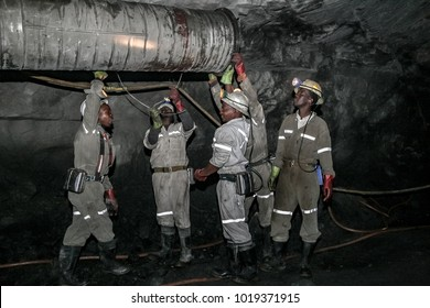 Northern Province, South Africa, 08/08/2011, Underground Platinum miners fitting a ventilation pipe