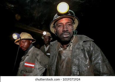 Northern Province, South Africa, 08/08/2011, Underground Platinum miners with mud on their face