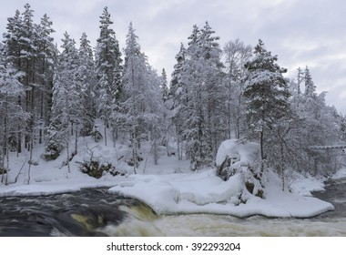 Northern river scenery in february with snow and ice