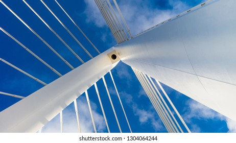 Northern Spire Cable Stayed Bridge in Sunderland spanning the River Wear.  Photo taken of the top spire of the bridge showing cables and the white metal structure against the blue sky.