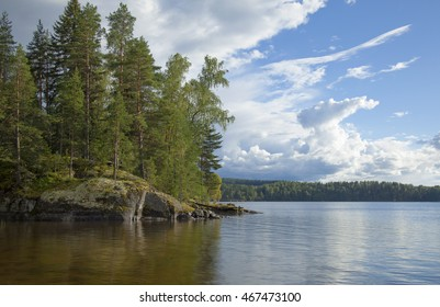 Northern summer - calm lake in Finland, rain clouds coming