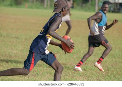 NORTHERN TERRITORY, AUSTRALIA - FEBRUARY 1 2009: Aboriginal men playing AFL (Australian Football Leauge) on a community in Arnhem land.