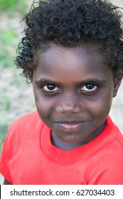 NORTHERN TERRITORY, AUSTRALIA - JANUARY 15 2009: A portrait of a  young aboriginal boy with smiley face.