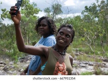 NORTHERN TERRITORY, AUSTRALIA - JANUARY 15 2009 : A young female aboriginal taking a photo of herself with her friend in the bushland in Northern Territory, Australia