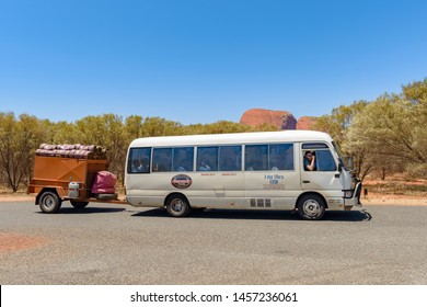 NORTHERN TERRITORY, AUSTRALIAN - OCTOBER 22: A tour bus from Alice Springs close to Uluru in the Northern Territories in Australia.