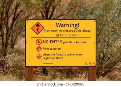 NORTHERN TERRITORY, AUSTRALIAN - OCTOBER 22: A hot weather warning sign close to Uluru, Ayres Rock, in Australia.