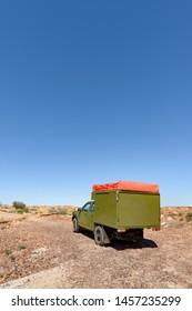 NORTHERN TERRITORY, AUSTRALIAN - OCTOBER 24: A rugged 4x4 campervan in an Australian desert.