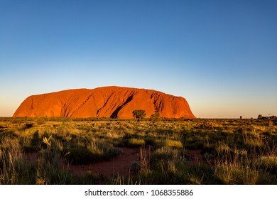 Northern Territory State, Australia-22-September-2016 : Sunset over Uluru, the largest monolith rock in the world, Unesco World Heritage site. Sunset view