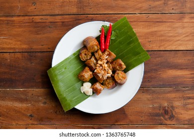Northern Thai food Chiang mai sausage or sai oua on white plate with wood table background