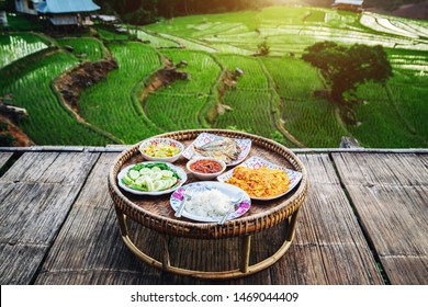 Northern Thai food. on a wooden table at beautiful landscape view of rice terraces and house at chiang mai , Thailand. Terraced Paddy Field in Mae-Jam Village chiang mai , Thailand. Color filter