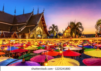 Northern Thai Style Lanterns at Loi Krathong (Yi Peng) Festival, Chiang Mai, Thailand, Colorful umbrellas and Thai Temple.