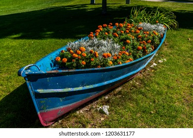 Northport, Michigan / USA 10 09 2018:   Rowboat used for flower bed at Grand Traverse Lighthouse, Leelanau Peninsula, Michigan, USA.