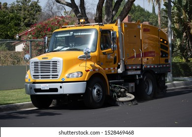 Northridge, California / USA -  October 11, 2019: Elgin Broom Bear CNG-powered Street Cleaning vehicle operating for Los Angeles City Street Services.