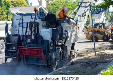 Northridge, California / USA -  September 25, 2019: Road crew operating a Wirtgen W 120 CFi cold milling machine removing old road pavement during repaving operation in Northridge.