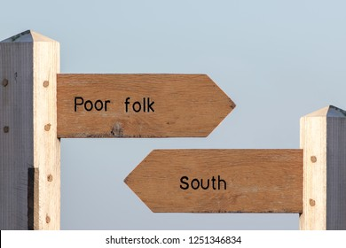 North-south divide. Economic, cultural and social division between the North and South UK. Standard of living between rich and poor areas. Divided Britain signposted.