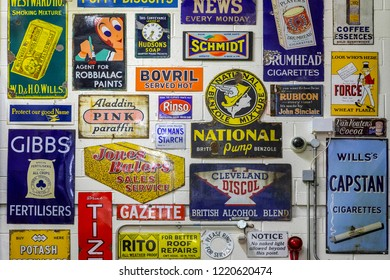 Northumberland. England. 04.18.18. Collection of vintage metal advertising signs at Beamish Open Air Museum in Northumberland in northeast England.