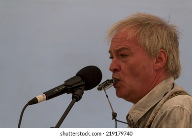 NORTHUMBERLAND, ENGLAND, AUGUST 30, 2014. Singer, songwriter, Steve Daggett, original member of band, Lindisfarne, performs at fund raising event. August 30, 2014, Northumberland, England, UK.
