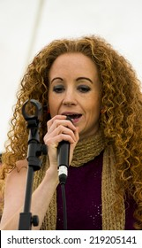 NORTHUMBERLAND, ENGLAND, AUGUST 30, 2014. Female singer, Rudi, performs at fund raising event in aid of Great North Air Ambulance. August 30, 2014, Northumberland, England, UK.