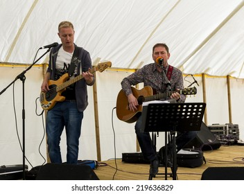 NORTHUMBERLAND, ENGLAND, AUGUST 30, 2014. Singer and guitarist, Gary Featherstone performs at fund raising event in aid of Great North Air Ambulance. August 30, 2014, Northumberland, England, UK.