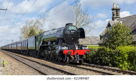 NORTHUMBERLAND. ENGLAND. MAY 15, 2016. The Flying Scotsman Steam Train passes through Clifton, Northumberland, on route from Edinburgh to York. May 15, 2016, Northumberland, England, UK.