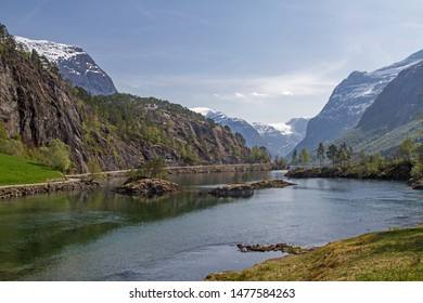 At the northwest end of Lake Lovatnet, the Loelva drain leaves the lake to flow into the Nordfjord