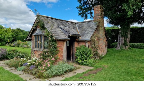 Northwich, Cheshire, UK. 07 14 2021 Elizabethan eighteen century half timber Tea Cottage within the grounds of Arley Hall and Gardens once used for tea and garden parties.