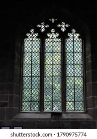 NORTHWICH, CHESHIRE WEST AND CHESTER, UK – JULY 11, 2019: Diamond patterned leaded glass window, in Gothic style, inside the historic St Mary and All Saints Parish Church of Great Budworth
