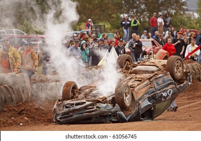 NORTON, CANADA - SEPTEMBER 11: A car overturns and finishes on its roof at a demolition derby on September 11, 2010 in Norton, Canada.
