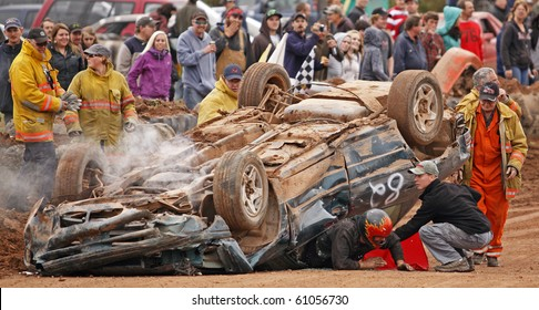 NORTON, CANADA - SEPTEMBER 11: The driver escapes after overturning his car at a demolition derby on September 11, 2010 in Norton, Canada.